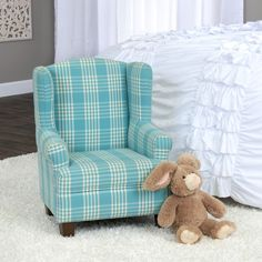 This adorable juvenile wingback chair is a miniature version of the traditional classic chair. The chair features a sturdy hardwood frame for structure and support. The premium woven fabric is a classic plaid with an ivory contrast thread. This chair will compliment any juvenile room dŽecor and be the perfect accent to create a pop of fun in a child's room. This chair also works in a family room, playroom or living room.