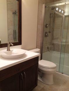 Bathroom AFTER micro Reno!  Vessel sink, glass door and gorgeous tile. #smallspacereno