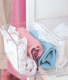 Clear plastic drawers make perfect storage quarters for neatly rolled scarves, underwear, and belts.