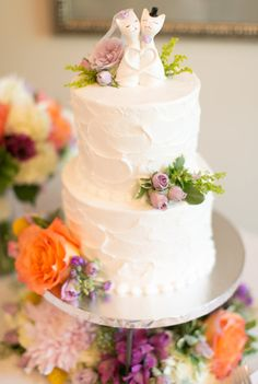 Two tier peach and purple wedding cake: Reception Catering: Weddings by JDK - http://weddingsbyjdk.com Catering: Weddings by JDK - http://weddingsbyjdk.com Floral Design: JDK Catering - http://www.stylemepretty.com/portfolio/jdk-catering Read More on SMP: http://www.stylemepretty.com/2017/05/18/fall-linwood-estate-wedding-pennsylvania/