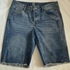 Denim boyfriend Jeans Bermuda Shorts Frayed edges cuff, super stylish!  Wear it rolled up or unrolled.   In place of the zipper,  there are 3 hidden  buttons to close. 5 functional pockets.  App measurements:  Waist 32. Hip 32. Front rise: 9.   Back rise: 13.5. Inseam: 10. Length: 20.  Leg width: 9.75 Mossimo Shorts Bermudas