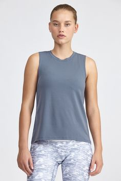 This classic muscle tank from Prismsport is made with performance fitness fabric and is great for...