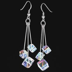 """Crystal Spectrum Earrings  Cut into tiny cubes, this trio of Swarovski aurora-borealis crystals dangles on individual wires to refract light in every color of the spectrum. Sterling silver; French hooks. Handcrafted in USA. 2 1/2"""" long.  ****  Crystal Spectrum Earrings  Item #:P132762  Price:$49.95"""