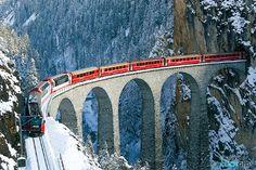 Bernina Express - Red Train from Rhätische Bahn on the famous LAndwasser Viadukt in Graubünden Switzerland. Chur Switzerland, Visit Switzerland, Bernina Express, Scenic Train Rides, Bonde, Train Travel, France Travel, European Travel, Vacation Trips