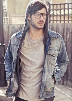 Denim shirt, over thin hooded sweater. A genius dash of style to a totally casual combo.