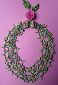 'A Ring of Spring' - daisy chain, cubic-right-angle-weave, stringing, and peyote stitch. Design credit to Diane Fitzgerald for the rose and large leaves. I do love daisy chain - but only with leaves added.... All that texture!