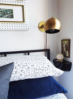 Space-saving #bedroom ideas. Love the #shelf and #brass sconce