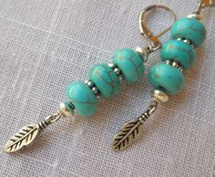 Turquoise and silver feather earrings.  Turquoise by KABADESIGNS