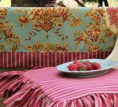 French Farmhouse premiere fabric collection -- red stripes and roosters -- table cloth and ruffled seat cushion.