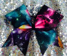 Galaxy cheer bow by SarahsCheerBows on Etsy https://www.etsy.com/listing/230235025/galaxy-cheer-bow