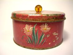 Vintage Tin Box.  The handle doesn't look to be original and if it is I suspect this to be from the 1940's...not being able to handle it though I could be wrong this could have been someone's bad attempt at tole painting....ha!
