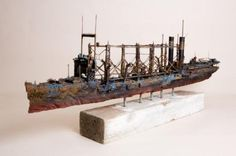 http://www.odditycentral.com/pics/artist-builds-one-of-a-kind-imperfect-boats-from-discarded-materials.html