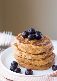 These gluten free and vegan Sweet Potato Pancakes with Peanut Butter Maple Syrup are ultra fluffy and tender! Made from healthy, whole food ingredients!