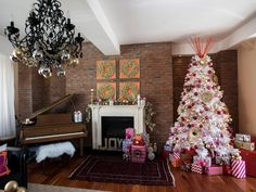 Celebrate the holidays with celebrities like Tiffani Thiessen, Kendra Wilkinson, Garcelle Beauvais and Lorenzo Lamas, as designers add a festive touch to their homes.