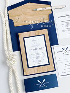 A classic boathouse look with real wood, navy blue and white for a elegant, nautical wedding!