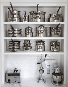 Dream Pantry - I'd love to own this may matching pans! Organized Pots, Pans & Small Appliance Storage