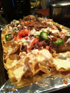 crockpot barbacoa beef nachos with white queso cheese dip