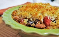 <p>Beans and veggies, bathed in a rich tomato sauce, and then topped with breadcrumbs and baked to crispiness. This dish is quite the comfort food!</p>
