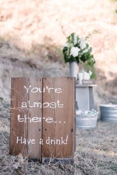 Country wedding sign--white painted letters on natural board.