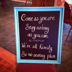 Wedding reception sign - we're all family so no seating plan!