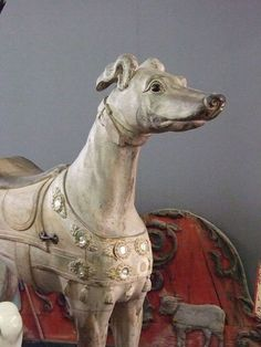 A beautifully carved greyhound that once graced an English roundabout (1)