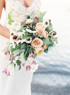 Anemone, rose and ranunculus wedding bouquet: http://www.stylemepretty.com/california-weddings/south-lake-tahoe/2016/10/19/colorful-california-wedding-inspiration/ Photography: Jacqui Cole - http://jacquicole.com/