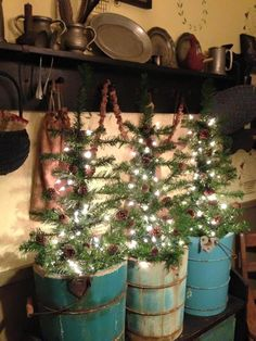 Posted on Olivia's Heartland - Some old buckets or vintage ice cream pails with mini trees and lights!