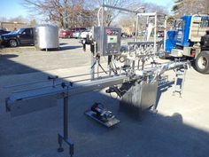 Filling Equipment Company Eight Spout Stainless Steel Automatic Liquid Filler With Conveyor