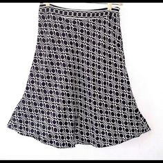 TOMMY HILFIGER SILK SKIRT NWOT Black white graphic print. Shell is 100% silk. Length is above the knee. Fully lined. Tommy Hilfiger Skirts