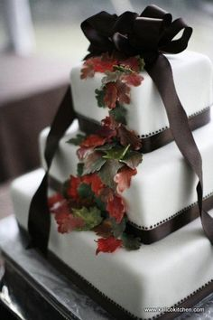 Wedding Cakes- 3 tier, fondant, fall leaves, brown ribbons and bow
