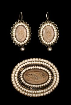 Circa 1860 Victorian mourning jewelry set of brooch and earrings. Set with seed pearls and black onyx.