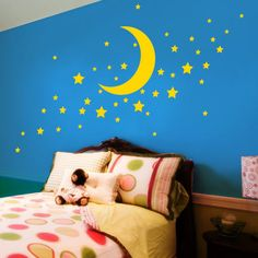 She is OBSESSED with the moon lately.  Maybe this design for her wall using the muted rainbow colors we like...hmmm