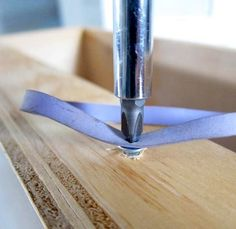 Stripped Screw -  Use a rubber band to provide some grip.