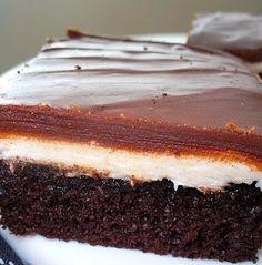 """Ho-Ho"" Cake - A moist chocolate cake with a super sweet and creamy vanilla buttercream filling and a chocolate glaze!"