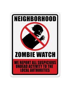 Décoration zombie Halloween : Ce panneau mesure environ 43 x 33 cm.Les inscriptions «NEIGHBORHOOD» et «ZOMBIE WATCH» sont imprimées sur un fond blanc et encadrent un...