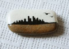 City skyline white winter sky birds hand painted art design | stone pebble rock brooch | wearable art gift