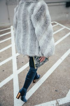 For an edgy outfit, pair a concert tee with cutoff denim shorts, over the knee boots and top it with a faux fur coat or a moto jacket. Click through for more details on this (super affordable) look and how you can recreate it!