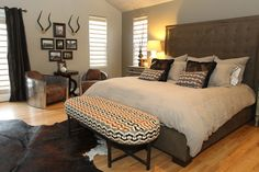 Headboard patterned fabric on bench at end of bed for master
