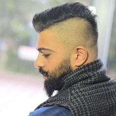Shaved sides and back men's hairstyle with beard