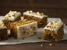 You'll fall in love with these pumpkin bars!  They have a light texture, are full of cinnamon, ginger, raisins and nuts and are topped with cream cheese frosting.