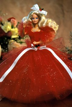 Gorgeous tulle, glitter and bows make a fab fashion statement for this Happy Holidays Collection doll. 1988 Happy Holidays® Barbie® Doll.