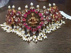 Stunning silver choker with Lakshmi ji motif. Choker with rice pearl hangings. Necklace studded with multi color stones. Indian Wedding Jewelry, Indian Jewelry, Bridal Jewelry, Indian Bridal, Gold Jewellery Design, Designer Jewellery, Gold Jewelry Simple, Antique Jewelry, Antique Gold