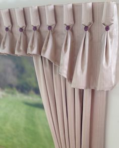 Goblet pleat valance. I like the detail pinching the pleat under the button