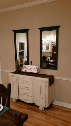 The shabby chic english buffet fits right in with the decor of the room and I love the two mirrors above it. Gorgeous!