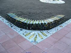 the beginning of up-cycled wine bottle fire pit by Chris Emmert