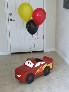 Cardboard Lightning McQueen - DIY instructions.  May be great centerpieces for tying massive amounts of balloons to?