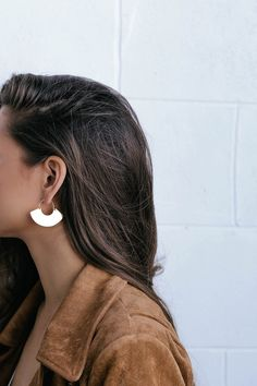 "You'll feel fancy in a flash when you finish your outfit with the Mireya Gold Earrings! Shiny gold fan-like charms dangle from curving fishhooks for a chic, minimal look. Earrings measure 1.25""."
