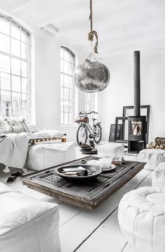 If your living room is big enough, you could try making a table from a door. This dramatic one, in an interior from Paulina Arcklin, appears to include the frame as well.