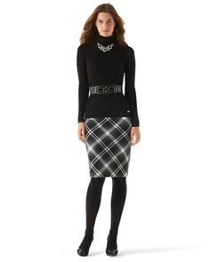 """BRISTOL PLAID PENCIL SKIRT STYLE: 570087932 Plaid has never look slimmer. Black, charcoal and ecru plaid is sewn on the bias to lengthen the feminine line of our beautifully tailored pencil skirt. Shell: 64% Polyester, 34% Rayon, 2% Spandex. Lining: 100% Polyester.Sits at the waist.Plaid matched at back center seam.Bandless waist piped in black georgette. Hip darts. Concealed back zip with hook/eye. 8"""" back vent bar-tacked at stress point. Soft, lightweight thread-tacked lining.Length: 24""""."""