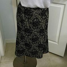 Ann Taylor Loft Skirt Black and grey skirt with flocked floral design design. LOFT Skirts Midi